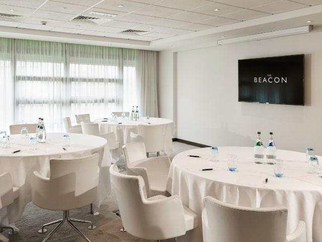 Meeting room with white tables & chairs